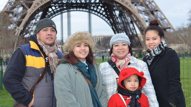 Amor Padilla Gatinao (second right) with her family in Paris. Pic: Family