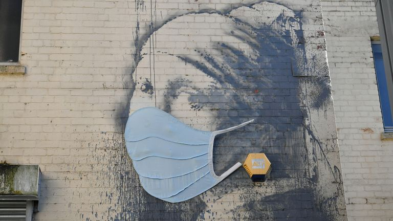 Banksy's Girl with a Pierced Eardrum mural in Hanover Place, Bristol has been given a face mask