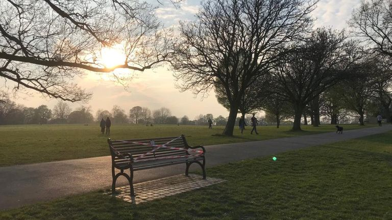 A bench is cordoned off in a London park, amid fears that pleasant weather over the Easter weekend could stop people staying at home