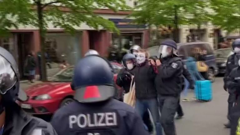 Police detain social distancing  protesters in Germany