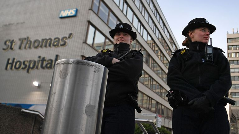 Police stand guard outside St.Thomas's Hospital in London. Pic: Andy Rain/EPA-EFE/Shutterstock
