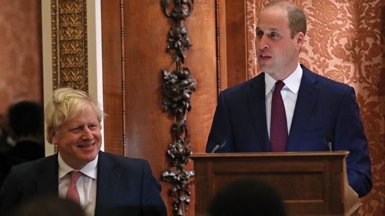 LONDON, ENGLAND - JANUARY 20: Prince William, Duke of Cambridge (R) speaks as UK Prime Minister Boris Johnson looks on during at a reception to mark the UK-Africa Investment Summit at Buckingham Palace on January 20, 2020 in London, England. (Photo by Yui Mok - WPA Pool/Getty Images)