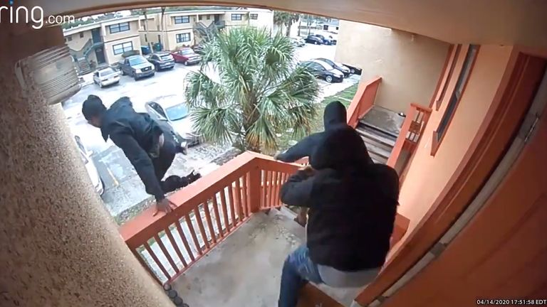 A suspected break-in has been caught on camera in which three men flea after entering the house and hearing gunshots.