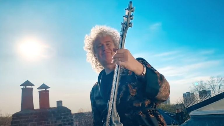 Brian May playing a bit of guitar while socially distancing up on the roof. YouTube/Get Up