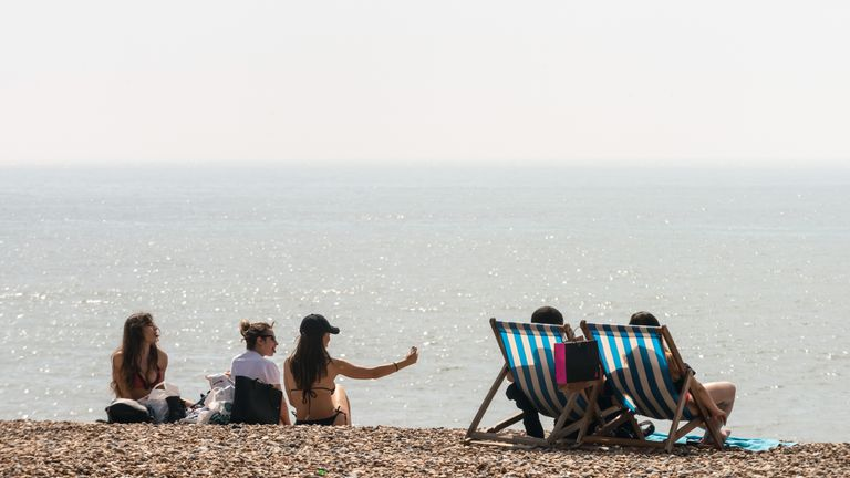 BRIGHTON, ENGLAND - APRIL 22 2019, a year before the Easter Lockdown: People enjoy the beach during the warm weather on Bank Holiday Easter Monday on April 22, 2019 in Brighton, England. This Easter weekend has broken previous hot weather records with the warm weather expected to continue into next week. (Photo by Andrew Hasson/Getty Images)