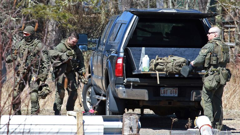 Royal Canadian Mounted Police (RCMP) members pack up after the search for Gabriel Wortman in Great Village, Nova Scotia, Canada April 19, 2020