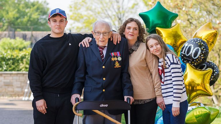Mandatory Credit: Photo by VICKIE FLORES/EPA-EFE/Shutterstock (10614773y).99-year-old British veteran Captain Tom Moore (2-L) with with grandson Benji (L), daughter Hannah Ingram-Moore (2-R) and granddaughter Georgia (R) outside his home after completing the 100th length of his back garden in Marston Moretaine, Bedfordshire, Britain, 16 April, 2020. Captain Tom Moore has raised over ..12 million for Britain's National Health Service (NHS) and has received donations to his fundraising challenge from around the world..British veteran raises millions for NHS by walking lengths of back garden, Marston Moretaine, United Kingdom - 16 Apr 2020