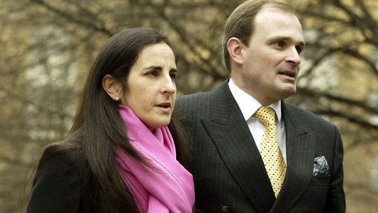 Charles Ingram (R) and his wife Diana arrive at Southwark Crown Court March 3, 2003 in London, United Kingdom. Ingram has been charged with deception and conspiracy after he and his wife Diana, and a business lecturer, Tecwen Whittock allegedly cheated to win the jackpot on the television quiz show 'Who Wants to be a Millionaire?'
