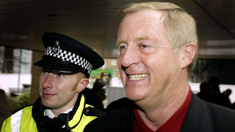 Gameshow host Chris Tarrant (L) arrives at Southwark Crown Court March 12, 2003 in London, United Kingdom. Tarrant was giving evidence in the case involving Charles Ingram who has been charged with deception and conspiracy after he and his wife Diana, and a business lecturer, Tecwen Whittock allegedly cheated to win the jackpot on the television quiz show 'Who Wants to be a Millionaire?'