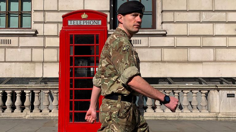 "A member of the military walks past a phone box in Westminster, central london, on April 15, 2020 as Britain continues to enforce a nationwide lockdown to halt the spread of COVID-19. - The new leader of Britain's opposition Labour Party urged the government today to set out how it plans to end the coronavirus lockdown, both to give people hope and avoid ""mistakes"" of the past. (Photo by DANIEL LEAL-OLIVAS / AFP) (Photo by DANIEL LEAL-OLIVAS/AFP via Getty Images)"