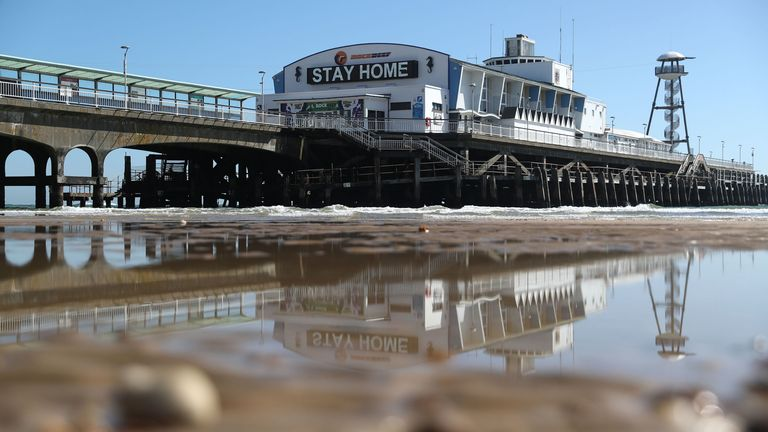 A 'Stay Home' sign is displayed on Bournemouth pier, as the UK continues in lockdown
