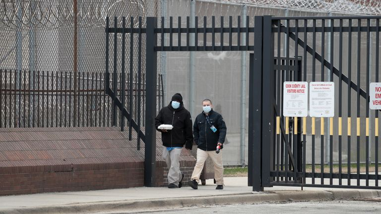 People wearing protective masks leave the Cook County jail complex on April 09, 2020 in Chicago, Illinois. With nearly 400 cases of COVID-19 having been diagnosed among the inmates and employees, the jail is nation's largest-known source of coronavirus infections