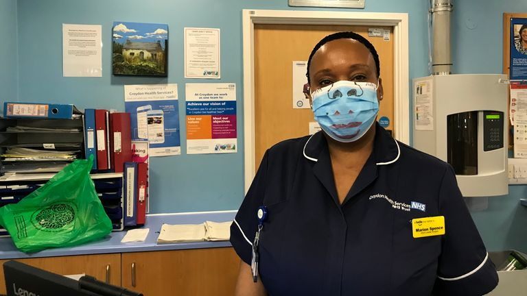 Ward leader Marion Spence at Croydon University Hospital has drawn features on her mask.