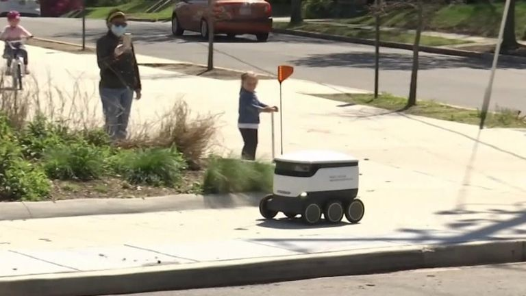 It's a surprising sight to see a self-driving delivery robot full of grocery items navigate a nearly empty sidewalk and crossing intersections.