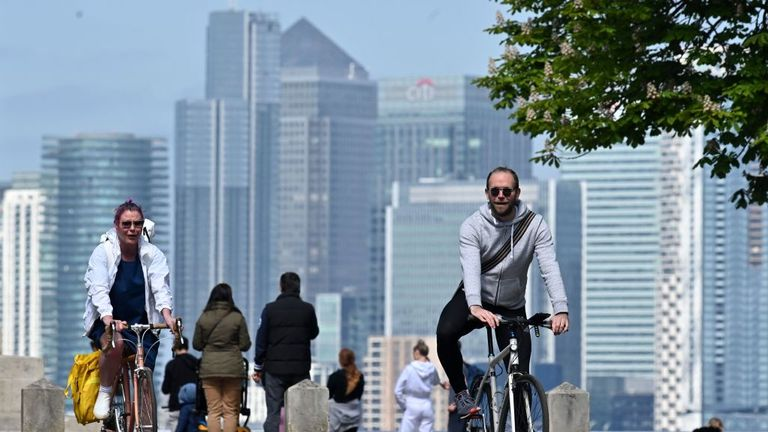 People take their daily excercise with the London skyline in the background, in Greenwich Park, south east London on April 25, 2020, during the national lockdown due to the novel coronavirus COVID-19 pandemic. - Prime Minister Boris Johnson is expected to return to work soon after his recovery from COVID-19, as pressure mounts on his government to explain how to get Britain out of lockdown. (Photo by JUSTIN TALLIS / AFP) (Photo by JUSTIN TALLIS/AFP via Getty Images)