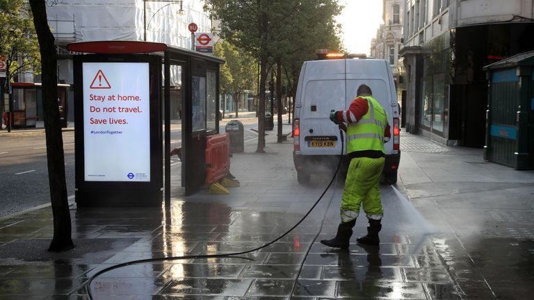 LONDON, ENGLAND - APRIL 17: A man is seen pressure washing the pavement on Oxford Street on April 17, 2020 in London, England. In a press conference on Thursday, First Secretary of State Dominic Raab announced that the lockdown will remain in place for at least 3 more weeks. The Coronavirus (COVID-19) pandemic has spread to many countries across the world, claiming over 130,000 lives and infecting more than 2 million people. (Photo by Andrew Redington/Getty Images)