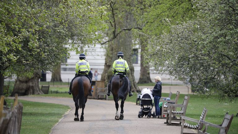 "Mounted police officers patrol in St James's Park in central London on April 17, 2020, after Britain extended its nationwide lockdown to tackle the novel coronavirus COVID-19 pandemic. - Britain on April 16 extended its lockdown to tackle the coronavirus for ""at least the next three weeks"", as it remains among the countries worst-hit by the pandemic with hundreds dying daily from the disease. (Photo by Tolga AKMEN / AFP) (Photo by TOLGA AKMEN/AFP via Getty Images)"