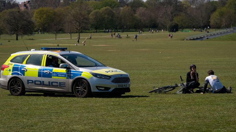 Police move on sunbathers in Regents Park, London, as the UK continues in lockdown