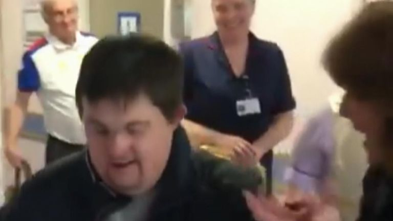 Ben McCafferty reunites with his mother after recovering from coronavirus and leaves hospital to applause from emergency workers