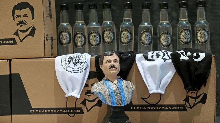 "A bust of the convicted drug kingpin Joaquin ""Chapo"" Guzman, is seen next to sanitizing gel and face masks, to be distributed by employees of the clothing brand ""El Chapo 701"", owned by his daughter Alejandrina Gisselle Guzman, as part of a campaign to help cash-strapped elderly people during the coronavirus disease (COVID-19) outbreak, in Guadalajara, Mexico April 16, 2020. The number 701 refers to the 2009 World's Billionaires ranking given by Forbes magazine to Mexican drug lord Joaquin ""El Chapo"" Guzman. REUTERS/Fernando Carranza"