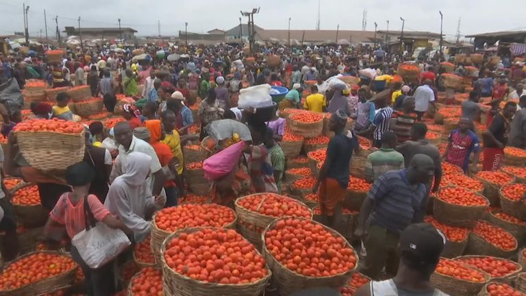 A large Lagos food market has been struggling to manage crowds amid Nigeria's coronavirus lockdown.