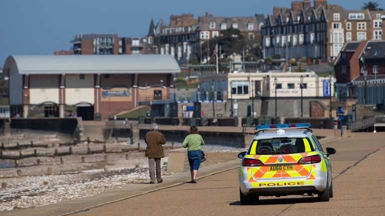 Police patrol the promenade at Hunstanton beach in Norfolk, as the UK continues in lockdown to help curb the spread of the coronavirus.