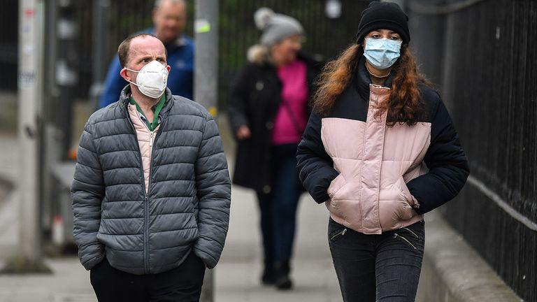 EDINBURGH, SCOTLAND - APRIL 17: Members of the public wear masks as the walk near the Mound during the coronavirus pandemic  on April 17, 2020 in Edinburgh, Scotland. The Coronavirus (COVID-19) pandemic has spread to many countries across the world, claiming over 120,000 lives and infecting over 2 million people. (Photo by Jeff J Mitchell/Getty Images)