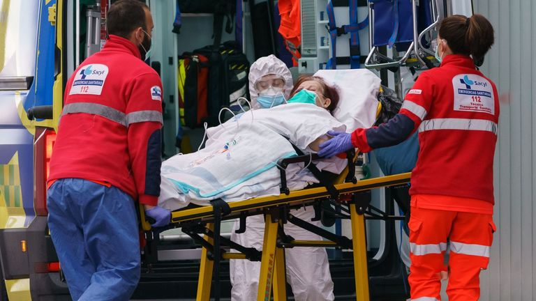 A woman is taken into a hospital in northern Spain