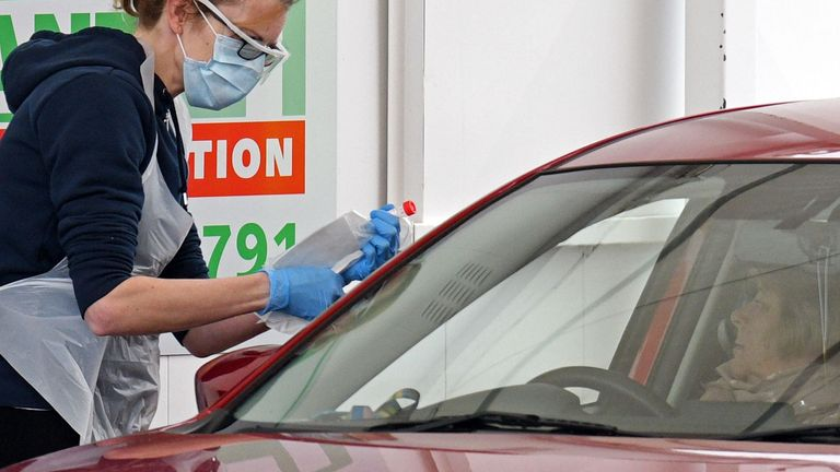 An NHS workers is swabbed at a drive-in test facility on the outskirts of Manchester