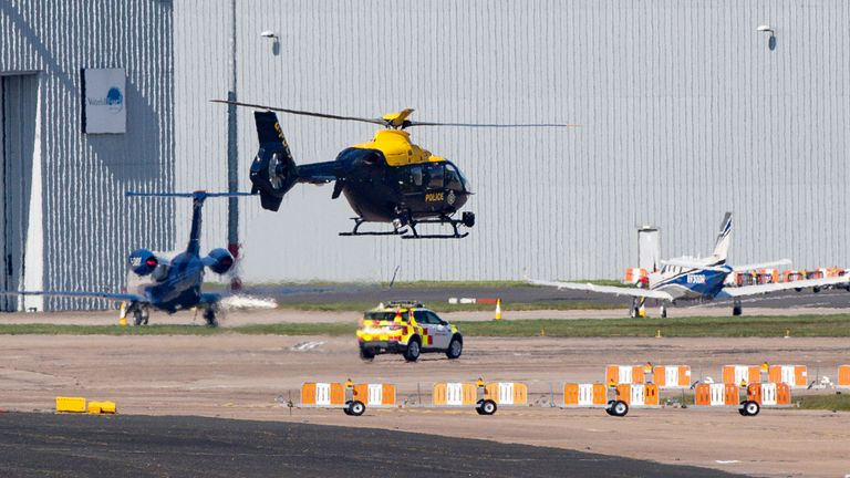 A police helicopter takes off by the temporary mortuary at Birmingham Airport which is reportedly set to become operational in the coming days, as the UK continues in lockdown to help curb the spread of the coronavirus.