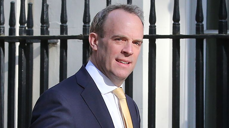 """Britain's Foreign Secretary Dominic Raab walks from the Foreign Office to 10 Downing Street in central London to attend the Government's daily COVID-19 briefing, on April 21, 2020. - The British government on Monday said there were """"encouraging signs"""" that the coronavirus outbreak was easing but warned it was too early to lift the lockdown despite new evidence of the economic toll. Some 16,509 people hospitalised with COVID-19 in Britain have now died, new health ministry figures showed, up by 4"""