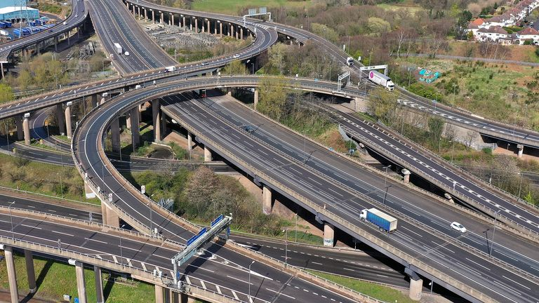 BIRMINGHAM, UNITED KINGDOM - MARCH 30: Traffic moves through Gravelly Hill Interchange, junction 6 of the M6 motorway where it meets the A38 Aston Expressway, commonly known as Spaghetti Junction, on March 30, 2020 in Birmingham, United Kingdom. Spaghetti Junction serves 18 routes and normally carries over 200,000 vehicles a day. During the lockdown only key workers and trucks are using the arterial road. The Coronavirus (COVID-19) pandemic has spread to many countries across the world, claiming over 30,000 lives and infecting hundreds of thousands more. (Photo by Christopher Furlong/Getty Images)