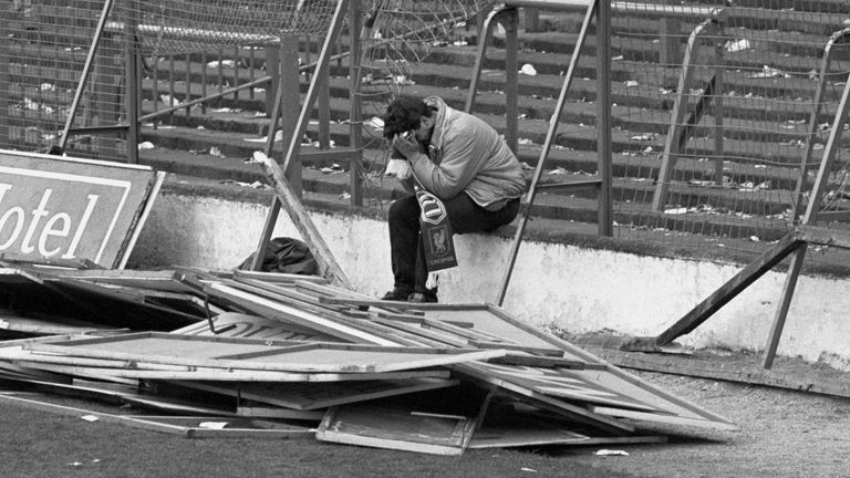 File photo dated 15/04/89 of a young Liverpool fan sitting on the terraces of Hillsborough with his head in his hands following the disaster at the FA Cup Semi Final game between Liverpool and Nottingham Forest in which 96 men, women and children died. Liverpool fan Dave Roland, who was captured in this poignant image in the aftermath of the Hillsborough disaster, has died after contracting coronavirus, his family have said.