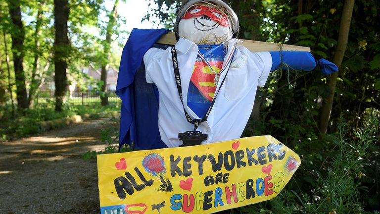 A figure representing a key worker is seen in a front garden as various scarecrows lighten the daily lockdown walk, as the number of the coronavirus disease cases (COVID-19) grows around the world, in the village of Capel in southern Britain, April 26, 2020. Picture taken April 26, 2020. REUTERS/Toby Melville
