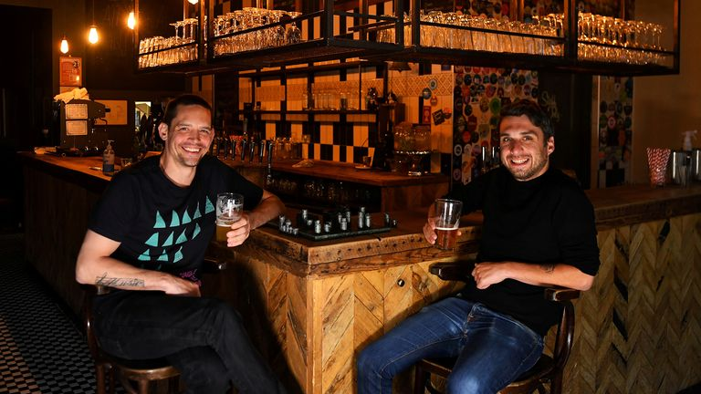 Steve Pond and Dominic Townsend enjoy a pint of beer and a game of chess at The Prince, a pub they share an apartment above and say are lucky enough to be stuck in during lockdown as the coronavirus disease (COVID-19) continues in London, Britain April 28, 2020. Picture taken April 28, 2020.  REUTERS/Dylan Martinez