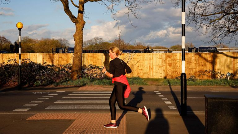 A woman out jogging in Manor Park, east London