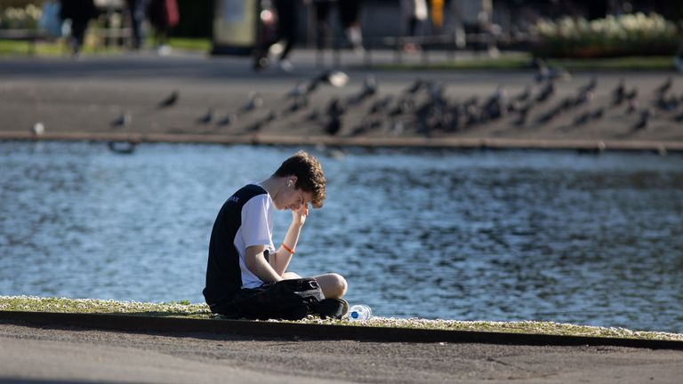 LONDON, ENGLAND - APRIL 04: A man reads by the lake in Regents Park on April 04, 2020 in London, England. The Coronavirus (COVID-19) pandemic has spread to many countries across the world, claiming over 60,000 lives and infecting over 1 million people. (Photo by Jo Hale/Getty Images)
