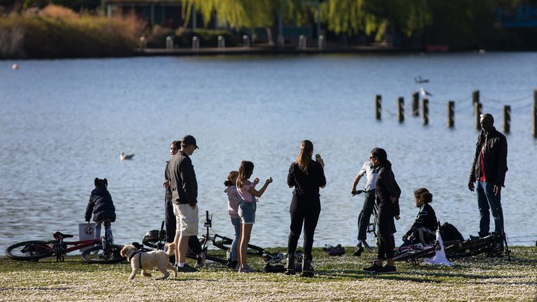 LONDON, ENGLAND - APRIL 04: People are seen by the lake in Regents Park on April 04, 2020 in London, England. The Coronavirus (COVID-19) pandemic has spread to many countries across the world, claiming over 60,000 lives and infecting over 1 million people. (Photo by Jo Hale/Getty Images)