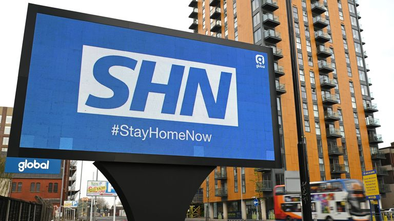 A billboard in Manchester urges Britons to stay at home over the Easter weekend