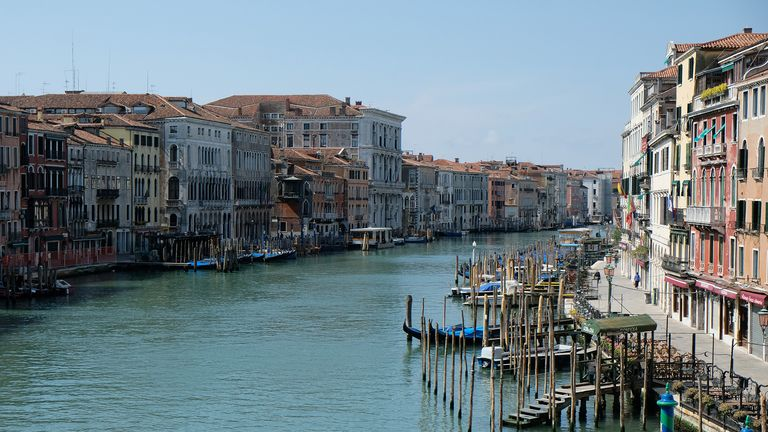 A general view of Grand Canal, which is almost deserted, seen from the Rialto Bridge, during the coronavirus disease (COVID-19) outbreak, in Venice, Italy, April 17, 2020. Picture taken April 17, 2020. REUTERS/Manuel Silvestri