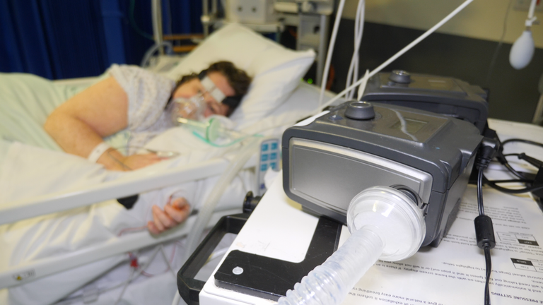 ICU patient Donna Wall next to a CPAP machine