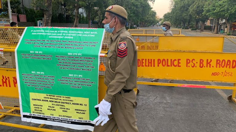Officers are seen patrolling the new barriers in Delhi
