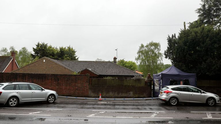 The home in Godstone is cordoned off by police