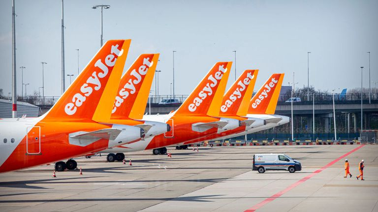 HAARLEMMERMEER, NETHERLANDS - 02 APRIL: Easyjet airplanes parked at Schiphol airport that closes piers and gates and downsizes the airport to the core of Schiphol during the Coronavirus COVID-19 crisis on April 02, 2020 in Haarlemmermeer, Netherlands. (Photo by Patrick van Katwijk/Getty Images)