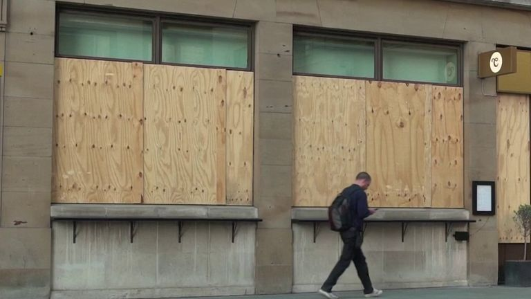 Boarded up shop on high street - economy