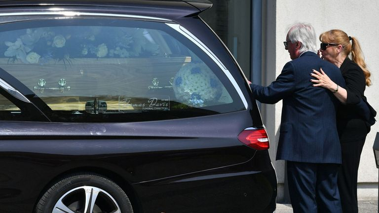 Syd Little and his wife, Sheree, pay their last respects to his comedy legend partner Eddie Large, before his funeral