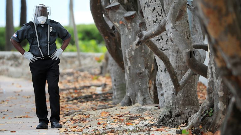 A security guard patrols the City of Miami Beach in Florida during the coronavirus lockdown