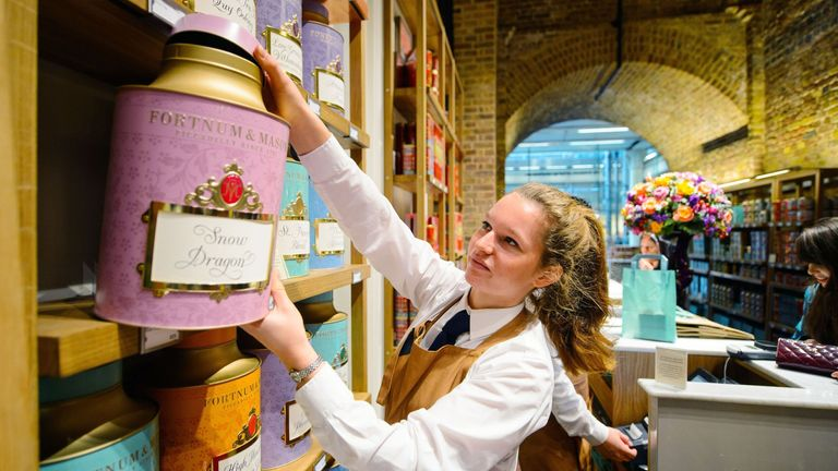 Staff prepare tea in the new Fortnum and Mason store, at St Pancras International Station, in central London, the first new Fortnum and Mason store to open in the UK for more than 300 years