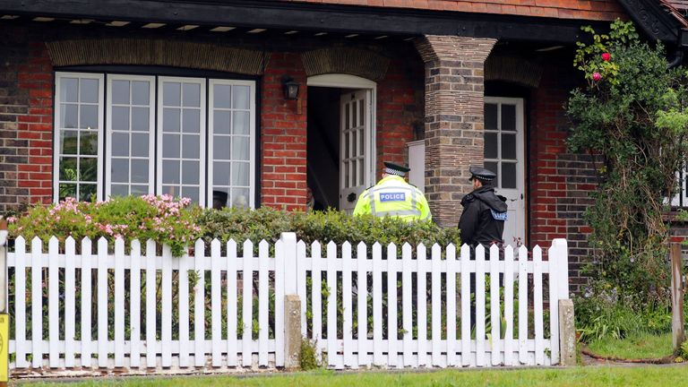 Surrey Police carry out enquiries after the death