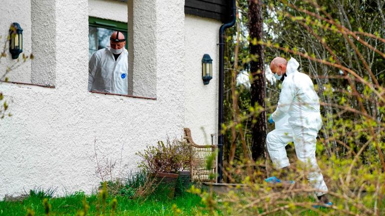 Policemen search the couple's home in Lorenskog near Oslo, after Tom Hagen's arrest